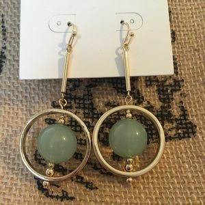 Gold circle earring with green ball